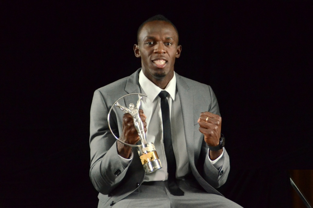 Bolt Poses With The Trophy