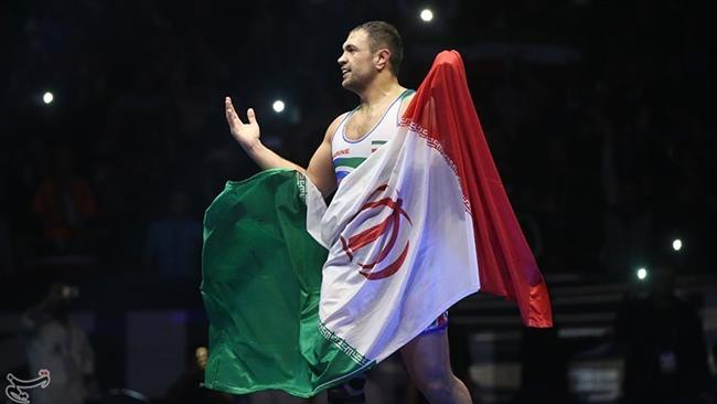 Iranian freestyle wrestler Komeil Ghasemi reacts after defeating American contestant Nick Gwiazdowski in the final 125-kilogram bout of the 2017 Freestyle World Cup at Imam Khomeini Sport Venue, Kermanshah, western Iran, on February 17, 2017.