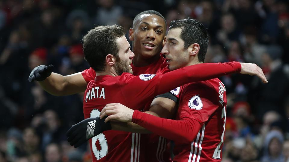 Manchester United's Anthony Martial (centre)celebrates scoring their second goal with Henrikh Mkhitaryan and Juan Mata, against Watford on Saturday. (REUTERS)