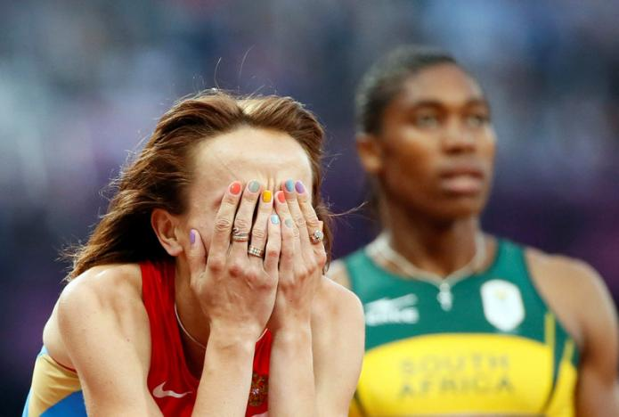 Russia's Mariya Savinova reacts after she won gold ahead of second placed South Africa's Caster Semenya in the women's 800m final at the London 2012 Olympic Games at the Olympic Stadium, Britain, August 11, 2012.