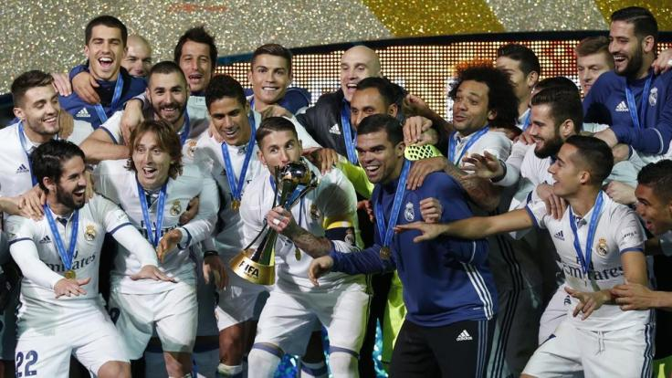 winning-madrid-trophy-sergio-ramos-celebrate-world_93e37fe6-c52e-11e6-913d-826c0833a15d