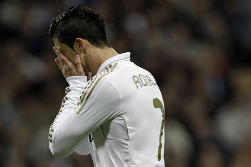 cristiano-ronaldo-551-hiding-his-face-and-crying-in-a-real-madrid-game-in-2012